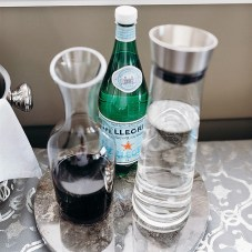 If you have a side board or island near, keep necessaries in reach - Water,Wine and some Pellegrino