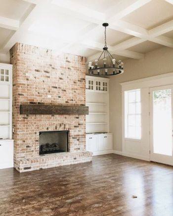 Classic brick and wood mantle balanced by a light bright palette on the walls= modern classics