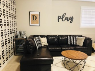 The D sign was a wedding gift but we reframed it in a black and white mat/frame combo so it wasn't hidden away. The play sign is awesome and from Etsy shop Ginger and the Huth