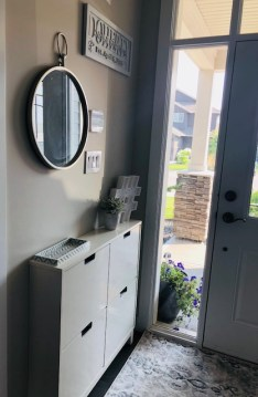 We added some nice style to the front entry as well. The Ikea show cabinet is mounted to the wall so it won't fall on little feet and holds up to 10 adult sized pairs of shoes.