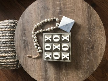 Little styling job- marble coasters, a game and some wooden beads for a relaxed welcoming vibe!