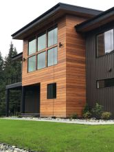 Showing that wood siding doesn't have to give off a cabin vibe.