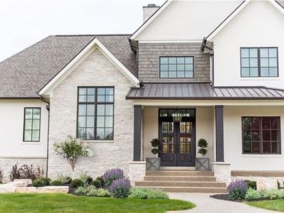 Elegant stucco with stone and shake accents.