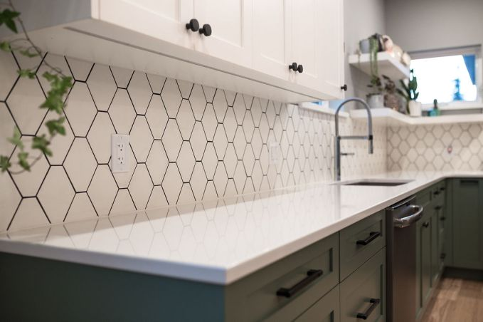 Oh this dreamy backsplash! I scooped this sample of tile up the day it hit the floor and we installed it vertical and with BLACK grout- Shawna was a little nervous but powered thru and the result is so good!