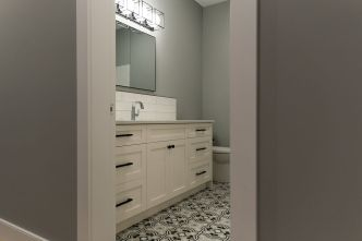 FUN but classic flooring was selected at Revelstoke flooring, Beautiful Quartz counters and a tile backsplash finish off this bathroom. In bathroom that will be used a lot, use the best materials you can budget for as they will stand the test of time!