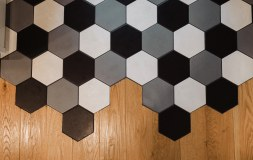 "We created a built in ""mat"" at the back door with a mix of hex tiles"