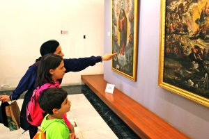 mom and kids looking at museum painting, Perfect Travel Destination, www.theeducationaltourist.com