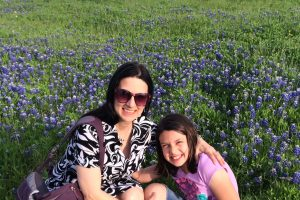 Mother and daughter in Texas bluebonnet field, Texas Bluebonnets - Illegal to Pick? www.theeducationaltourist.com