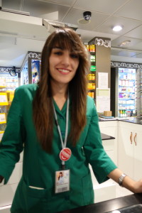 Young woman with dark hair Pharmacist in Madrid, first aid kit, www.theeducationaltourist.com