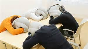 group of office workers resting on table with ostrich pillows