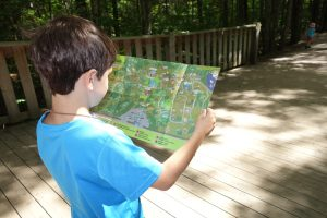 little boy with a map, Canada Travel Itinerary, www.theeducationaltourist.com