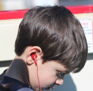 Boy with earbuds, Vacation Photos TIPS, www.theeducationaltourist.com