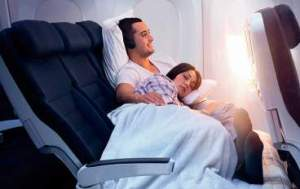 Couple on a plane, woman asleep, Travel Annoyances, www.theeducationaltourist.com
