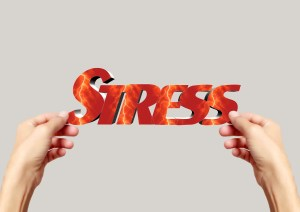The word stress being held by hands, Travel Relieves Stress