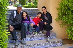 family sitting on steps, travel myths