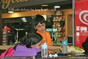 Kids waiting in a cafe, Traveling with Kids: Top Tips, www.theeducationaltourist.com