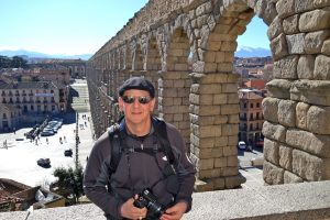 man at Segovia's aquaduct,  Planning a Family Adventure, www.theeducationaltourist.com