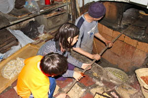 kids making bread in moroccan oven, Planning a Family Adventure, www.theeducationaltourist.com