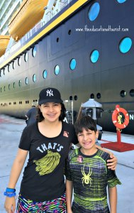 boy and girl at port off of a cruise ship