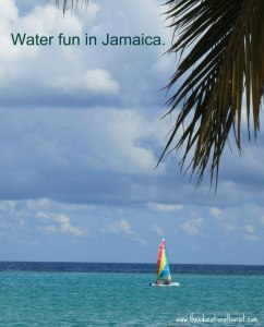 blue water and blue sea with colorful sailboat, water fun in jamaica, www.theeducationaltourist.com