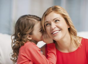 child whispers to smiling mom, Travel and Family Connections, www.theeducationaltourist.com