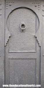 Grey keyhole arch on ornate Moroccan door, Moroccan Doors, www.theeducationaltourist.com