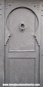 Grey keyhole arch on ornate Moroccan door, Moroccan Doors, www.theeducationaltourist.com