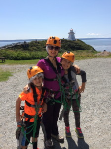 The Educational Tourist and kids at Cape Enrage, Canada wearing gear for zip lining, About The Educational Tourist, www.theeducationaltourist.com