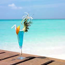 mixed drink on sandy beach