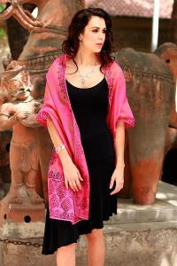 woman in black dress wearing large pink scarf photo from Novica , Gift Ideas for the Lady Traveler, www.theeducationaltourist.com