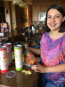 girl with snacks, Road Trip Hacks and Snacks, www.theeducationaltourist.com