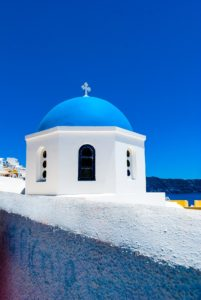Blue domed church roof in Santorini, trips to greece
