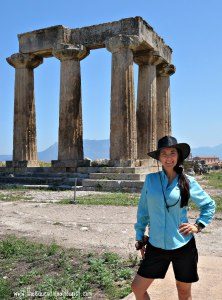 The Educational Tourist in Ancient Corinth, Greece in front of the Apollo Theatre in Greece