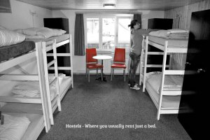 hostel bedroom with bunk beds,woman making the bed says Hostels - you where you usually just rent a bed.