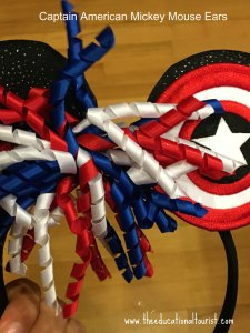 Mickey Mouse ears on a headband with red, white and blue curly bow and Captain American shield