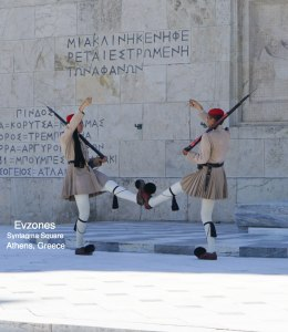 Evzones walk about at the top of each hour guarding the tomb of the unknown soldier in Syntagma square in Athens, Greece