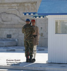 Evzone guard and his 'keeper' at Syntagman Square in Athens, Greece