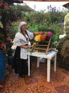 woman making silletera flower farm Medellin