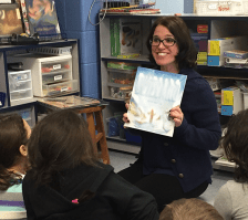 A TheEdCollab literacy consultant reads aloud during a reading workshop with students