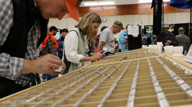Purchasing flies at the Fly Fishing Rendezvous