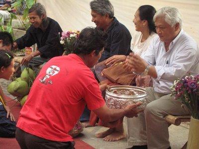 Offering water to elders