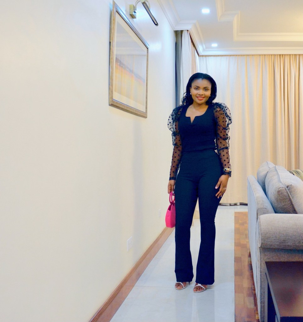 Black flared pants with black puff sleeve top styling ideas