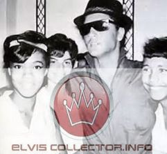 WM 1960s Elvis wearing sunglasses and hat with 3 young women
