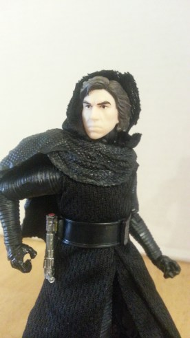 Kylo goes for his weapon