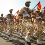Members of the Iranian revolutionary guard march during a parade to commemorate the anniversary of the Iran-Iraq war (1980-88), in Tehran