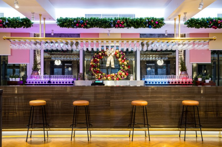 Bar decorated with Christmas Garlands and Wreath by Curious Events