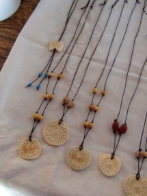 Necklaces made with spinal disks from a dolphin (skeleton found on beach)