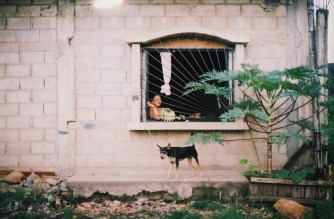Ecuadorian woman and dog (by Tanner Hoss)