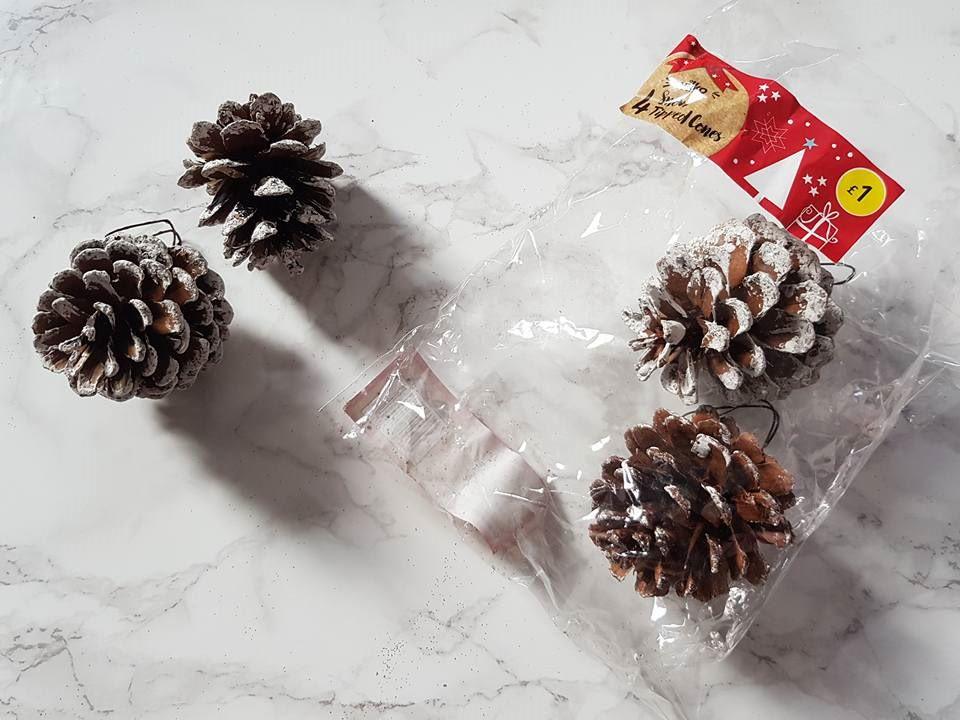4 snowy pine cones