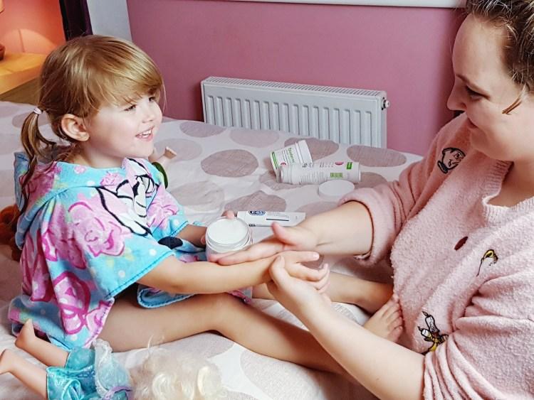 Putting cream on Shaniahs skin